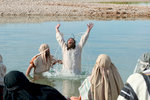 Lifting Hands After Baptism
